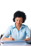 Elder Woman Writing. Elder woman writing something with a pencil Stock Photos