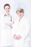Elder woman and young doctor Royalty Free Stock Photo