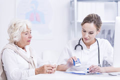 Elder woman and young doctor Royalty Free Stock Photography