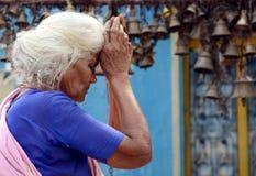 ELDER WOMEN IN DEEP PRAYER. Indian elder woman in deep prayer Royalty Free Stock Images