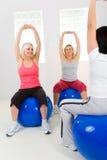 Elder women exercising on fitness balls Stock Photography