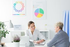 Consultation with dietician. An elder women during her consultation with a dietician. Healthy living concept stock image
