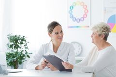 Elder woman during dietician consultation stock photo