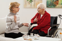 Elder women meeting Stock Image