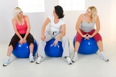 Elder women sitting on fitness balls Royalty Free Stock Photos