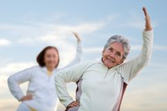 Elder women stretching Royalty Free Stock Photo