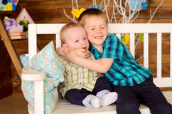 Elder and younger brothers on bench Stock Images