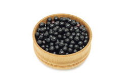 Elderberries in a wooden bowl Stock Photo