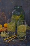 Elderberry flowers and lemon drink. Refreshment healthy elder juice. Glass of elderflower lemonade on wooden rustic board. Alterna. Tive medicine and therapy Stock Photo