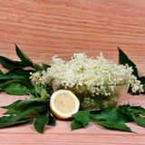 Elderberry flowers and lemons Royalty Free Stock Photo