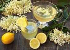 Elderberry juice. Elderberry flower flavored summer refreshment cocktail with sliced lemon Stock Photo