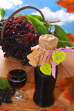 Elderberry juice and fresh fruits in the basket Royalty Free Stock Photos