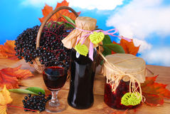 Elderberry juice and fresh fruits in the basket Royalty Free Stock Photo