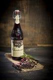 Elderberry wine and elderberries on wooden table Royalty Free Stock Image