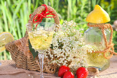 Elderflower champagne and strawberries Royalty Free Stock Images