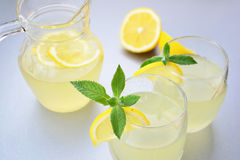 Elderflower juice with lemon. Pitcher and two glasses of natural elderflower juice with lemon - shallow DOF Royalty Free Stock Photography