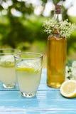 Elderflower lemonade and bottle of homemade syrup Stock Photo