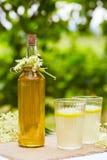 Elderflower lemonade and bottle of homemade syrup Stock Image