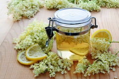 Elderflower syrup with blossoms Royalty Free Stock Photos