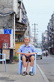 Elderley Chinese man sits on a plastic chair outside, Xiang Yang, China Stock Photos