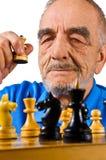 Elderly. The elderly man playing chess royalty free stock photo