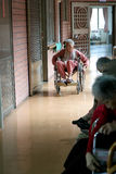 Elderly. Fushing Village, Taiwan, March 30, 2010. An elderly woman moving on a wheelchair in Christian Renai Nursing Home, in Fushing Village, Taiwan. Very Royalty Free Stock Photo