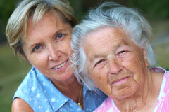 Elderly. Woman with her daughter. Focus on the senior woman royalty free stock photos