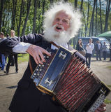 Elderly accordionist - singer of folk songs at the Bottom of the city in the Republic of Belarus.
