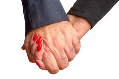 Elderly affectionate couple holding hands Stock Image