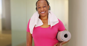 An elderly African American woman poses for a portrait after her workout royalty free stock image