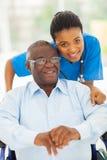 Elderly african man caregiver