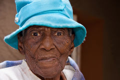 Elderly african woman. Closeup portrait of a hundred and three year old black african woman Stock Photos