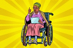 Elderly African woman disabled person in a wheelchair, gadget ta Stock Photo