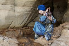 An elderly Arab woman with a jug royalty free stock photography