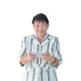 Elderly Asian Business woman using smartphone isolated on white Royalty Free Stock Images