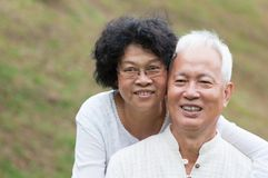 Elderly Asian couple relaxing outdoor. Portrait of old Asian couple relaxing at outdoor park Stock Images