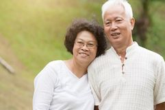 Elderly Asian couple smiling outdoor. Royalty Free Stock Image