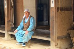 Elderly asian craftsman near artisan workshop royalty free stock photo