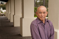 Elderly asian man. Standing outside senior apt Stock Photos