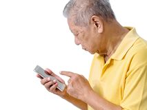 Elderly asian men are using a smartphone to play an application for the elderly. easy to use smartphone online banking, payment on Stock Photo