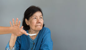 Elderly asian woman bored with food Stock Photos