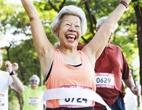 Elderly asian woman reaching the finish line royalty free stock image