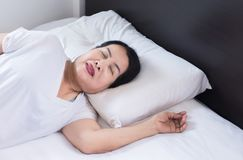 Elderly asian women sleeping on the bed and grinding teeth,Female tiredness and stress. Elderly asian female sleeping on the bed and grinding teeth,Female stock photography