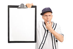 Elderly baseball coach holding a clipboard Stock Image