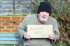 Homeless man with a cardboard help sign. stock images