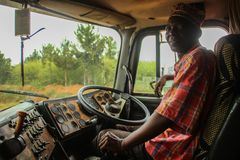 Elderly black African driver driving old truck stock photography