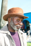 Elderly black man. An elderly black man with a scruffy gray beard relaxes at a park on a sunny day Stock Photo