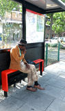 Elderly black man sitting at the bus stop Stock Images