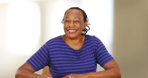 An elderly black woman smiling at the camera Royalty Free Stock Image