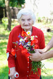 Elderly with a bouquet Royalty Free Stock Photography
